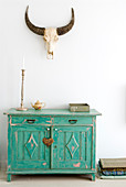 Hunting trophy above turquoise, shabby-chic cabinet