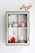 Crockery in small, wall-mounted cabinet