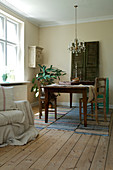 Wooden table on three runners as a carpet in the dining room in natural tones