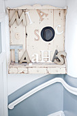 Decorative letters on shabby-chic shelf