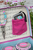 Handmade, feminine tool box in shades of pink and pale blue