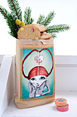 Paper bag with cookies and pine green pasted with a picture