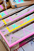 Pallet covered with colored washi tape