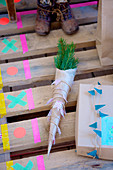 pine branches wrapped in paper with a pennant chain made of washi tape