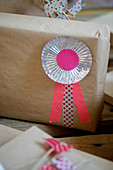 Rosette made from praline molds and masking tape on a wrapped gift