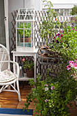 Lush greenery and summery flowers on balcony
