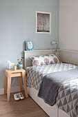 Scandinavian style bedroom in shades of gray with a graphically patterned ceiling