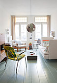 Bright living room in period apartment with retro ambience