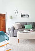 Grey sofa and ottoman in living room