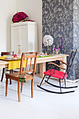Solid wood table with antique wooden chair and rocking chair