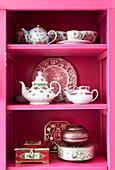 Nostalgic dishes on a pink shelf