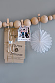 DIY garland of wooden beads and clothes pegs used as mood board