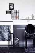 DIY-Bilder an weißer Wand mit dunkler Holzverkleidung