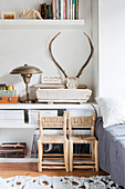 Two children's chairs in front of accessories on low sideboard