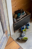 Sports shoes in wooden crate