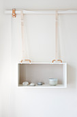 Hanging box as a wall shelf with a simple decoration
