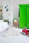 Neon-green wardrobe in white child's bedroom