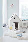 Cardboard wendy house in bright child's bedroom