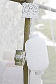 White lantern and lantern hung in the garden