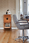Retro swivel chair in front of an antique cabinet in an old building
