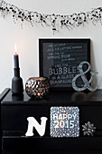 Winter decoration in black with pearl garland and typeface