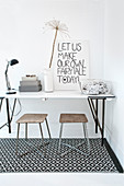 Slimline desk and two stools on black-and-white patterned rug