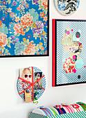 Bilder, Collage und kleine Pinnwand aus gemustertem Papier