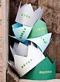 Homemade paper crowns with names for children's birthday parties