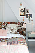 Cushion with stag motif and patchwork quilt on bed