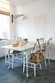 White-painted wooden table and chairs