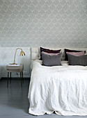Bedroom with vintage wallpaper and knee-high bed