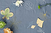 An embroidered cloth with autumnal leaves