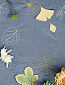 Embroidered cloth with autumn leaves
