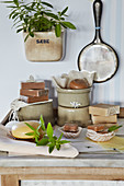 Still life made of honey soap, clay pots, and verbena branches