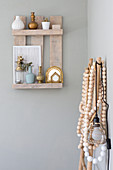 Rustic small wall shelf made of boards with boho-style decoration