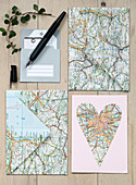Homemade envelopes and cards from old maps
