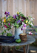 Summer bouquet of sweet peas, marigolds, dill flowers and asters