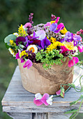Summer bouquet of sweet peas, everlasting flowers, chrysanthemums, goldenrod, and spinach seeds