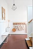 Minimalist hallway in natural tones with tiled floor