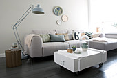 White wooden box as a coffee table in the living room in gray tones