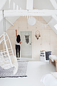 Bright built-in wardrobe and hanging chair in the attic