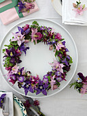 Wreath of different columbines in pink, violet and lilac