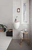 Hand basin and wooden stool in the corner of the room