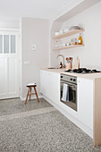 White kitchenette and terrazzo floor