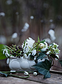Snowdrops and ivy with ivy berries in a bowl