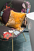 A chair with a floral pattern and cushions