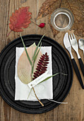 Autumnal plate decoration with pressed leaves