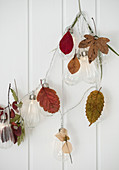 Fairy lights with autumn leaves
