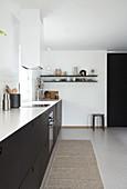 Kitchenette with dark front in white kitchen