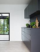 A black fitted kitchen